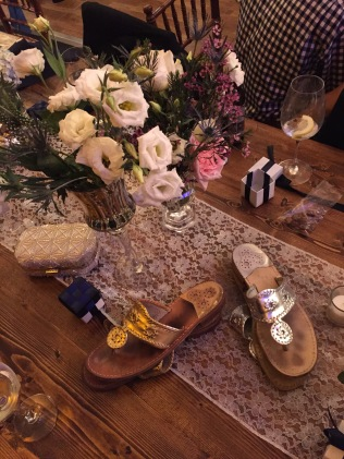 The centerpieces were beautiful fresh flowers in horse show trophy cups. Metallic sandals were the bridesmaid shoe of choice- here are some of our Jack Rogers taking a break while we danced!